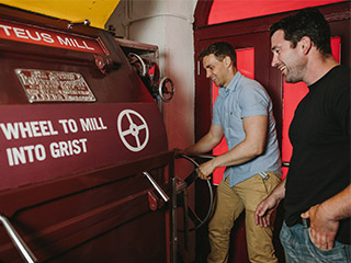 Visitors checking the grist at Smithwicks Experience Tour in Kilkenny